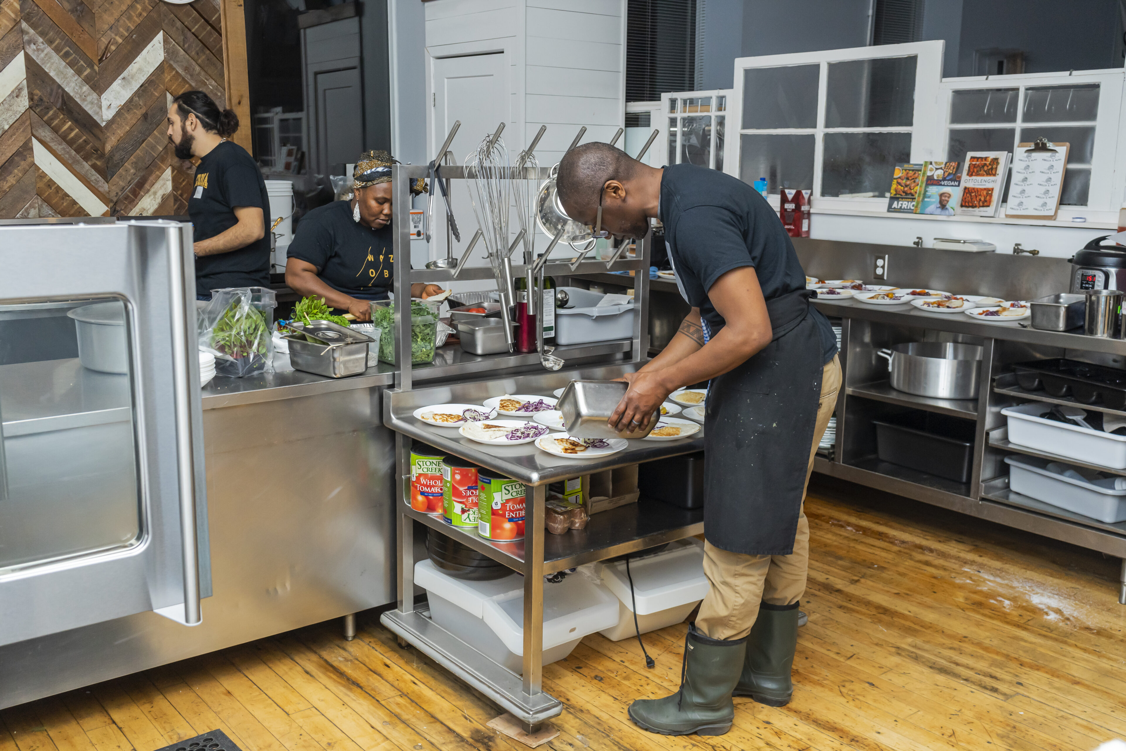 a male chef plating tasty dinner in the kitchen